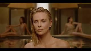 Charlize Theron walking naked out of a pool is what female empowerment looks like in Dior's world