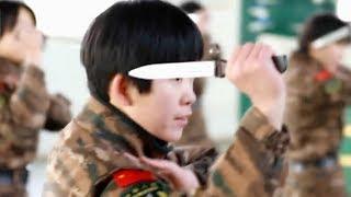 How do China's female Falcon Commandos perform their daily training?