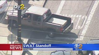Female Suspect Remains Hold Up In Truck During Standoff With Police