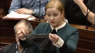 Irish politician Ruth Coppinger shows women's thong in parliament in sex assault protest
