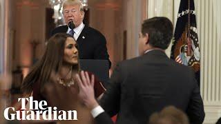 White House accuses CNN's Jim Acosta of 'placing his hands' on young 'intern'