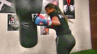 Amazing female youth boxer just starting out working the heavy bag
