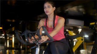 Focused young women / female working out on the exercise bike ... | Indian Stock Footage | Knot9