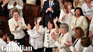 Trump surprised by response from women in white during State of the Union address