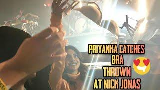 A fan thrown her bra on nick jonas face and suddenly priyanka catches it in mid-air