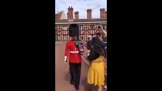 Queen's guard a guardsman female tourist she stepped over a rope outside Windsor Castle