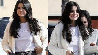 Selena looks in bright Christmas spirits  while out with female pal in LA