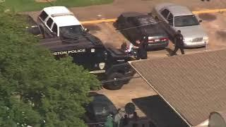 RAW VIDEO: Female suspect in custody after bizarre roof standoff in N. Houston