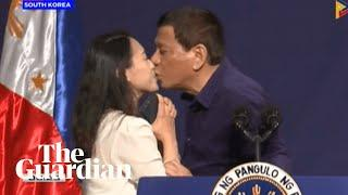 Rodrigo Duterte kisses woman during public event