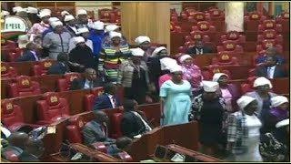DRAMA IN PARLIAMENT AS ALL FEMALE MPs WALK IN WITH WAKARINO HEADGEARS  OVER TWO-THIRDS GENDER RULE