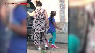 Video: woman arrested after kids spotted in dog kennels