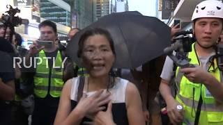 Hong Kong: Woman attacked by anti-govt. protesters as violence continues
