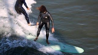 Surf School Owner Aggressively Pulls Female Surfer's Leash
