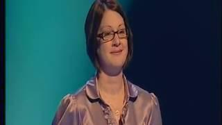 Female Game Show Contestant in Satin Blouse