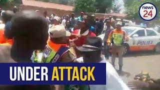 WATCH | Angry mob attack women metro cops outside Joburg mall