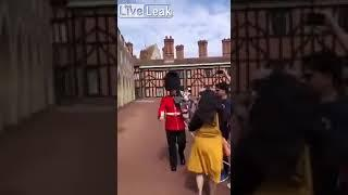 Woman pushed away by royal guard