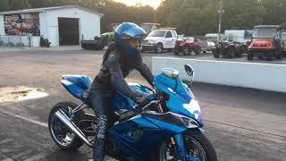 Attractive Female Motorcycle Drag Racer Tries to Take Down One of the Best