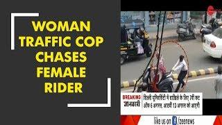 Morning Breaking: Woman traffic cop chases a female driver breaking signals